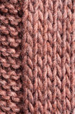 Formula right and left. Pattern knitted from wool brown orange Stock Images