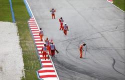 Formula 1. Sepang, Malaysia - April 04, 2010: The staff at the track Formula 1 race in Sepang, Malaysia Royalty Free Stock Images