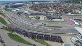 The formula 1 track in Sochi, the Olympic village in Sochi. Building site of stadium for racing near town and mountains Stock Photos