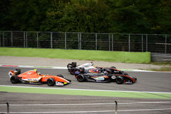 Formula V8 3.5 cars at Monza. Three Dallara-Renault Cars during the 2016 race at the Autodromo Nazionale Monza Royalty Free Stock Images