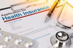 Formulario de inscripción para el seguro médico Imagen de archivo libre de regalías