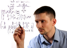 Formulas. An image of man with pen in hand. Write formule royalty free stock image