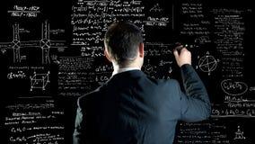 Formule chimiche e fisiche di scrittura Immagine Stock