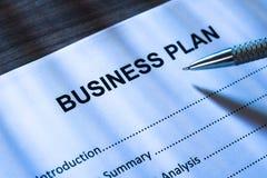 Formulário da pena e do plano de negócios Imagem de Stock