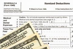 Formulários de imposto federal para deduções dos artigos Foto de Stock Royalty Free