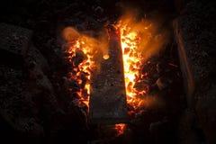 Fornace con carbone e la sbarra di ferro Fotografia Stock
