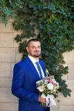Fornal w eleganckim błękitnym kostiumu Obraz Royalty Free