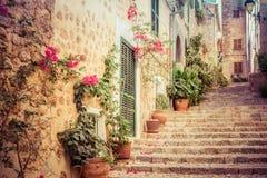 Fornalutx village on mallorca. Medieval street with potted flowers in fornalutx village mallorca Stock Photo