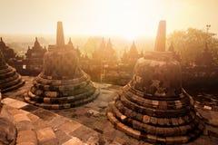 Fornminne av Borobudur den buddistiska templet på soluppgång, Yogyakarta, Java Indonesia Arkivbild