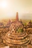 Fornminne av Borobudur den buddistiska templet på soluppgång, Yogyakarta, Java Indonesia Fotografering för Bildbyråer