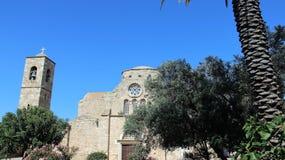 Forntida basilika med klockatornet royaltyfria foton