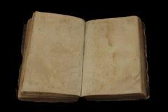 Forntida bok med blanka sidor för egentext Arkivfoton