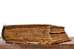 Forntida bok på vit bakgrund Arkivbilder