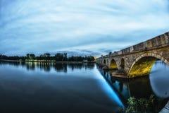 Forntida bro för soluppgång och för moln Royaltyfri Fotografi