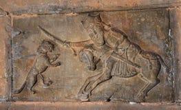 Forntida carvings på en sten Arkivbild