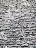 Forntida cobblestoned trottoarbakgrund Arkivbild