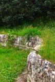Forntida fördärvar av en stenvägg Arkivbild