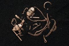 Forntida guld i sand royaltyfri foto