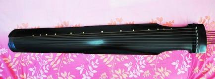 Forntida kinesiskt musikaliskt instrument arkivfoto