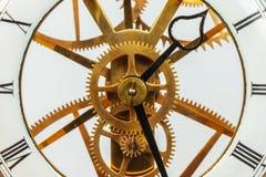 Forntida klocka med kugghjul Royaltyfria Bilder