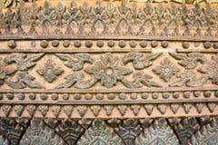 Forntida Laos konstvägg som snider i Hor Phakeaw Arkivfoton