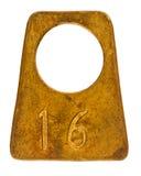 Forntida mässingseffektförvaringetikett med nummer 16 Arkivfoto