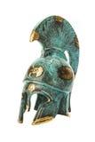 Forntida mässingsgrekisk hjälm för souvenir över vit Arkivbild