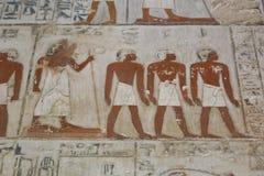 Forntida målning på väggen på egyptiska gravar Fotografering för Bildbyråer