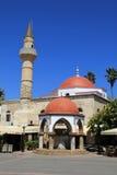 Forntida moské på den grekiska ön av Kos med minaret Fotografering för Bildbyråer