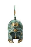 Forntida mässingsgrekisk hjälm för souvenir över vit Royaltyfri Fotografi