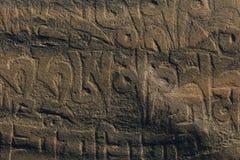 Forntida Om Mani Stone Carving Arkivfoto