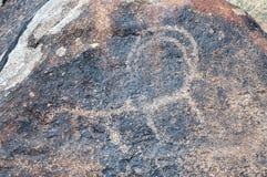 Forntida petroglyph på stenen Royaltyfria Foton
