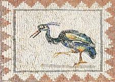 Forntida roman mosaik som föreställer en häger, Sevilla Arkivbild
