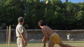 Forntida Rome femkampdiskus som kastar ultrarapid lager videofilmer