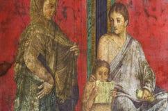 Forntida romersk freskomålning i Pompeii som visar en detalj av gåtakulten av Dionysus Royaltyfri Bild