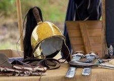 Forntida romersk roder och annan krigutrustning Royaltyfri Fotografi