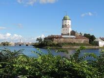 Forntida slott på en liten ö Arkivfoto
