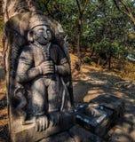 forntida stena statyn av guden i en tempel royaltyfri foto