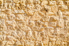 Forntida stenhuggeriarbete, fragment av en vägg Arkivbild