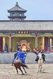 Forntida stilhästshow på Hengdian världsstudior, Kina Arkivbilder