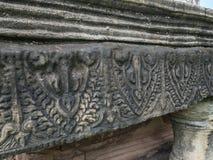 Forntida stilmodell på sandstenen som snider på historiska Phimai Royaltyfri Foto