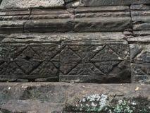 Forntida stilmodell på sandstenen som snider på historiska Phimai Royaltyfria Bilder