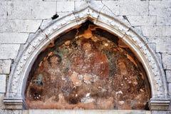 Forntida symbol på väggen av en forntida kristen tempel croatia fotografering för bildbyråer