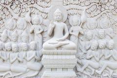 Forntida tegelsten som snider konst av Buddha Arkivbilder