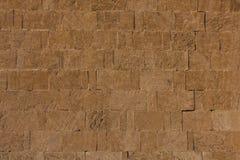 forntida tegelstenvägg Arkivfoto