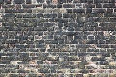 forntida tegelstenvägg Arkivbild
