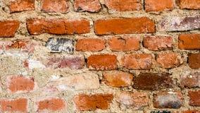 Forntida tegelstenvägg för röd lera, textur för bakgrund Royaltyfri Foto
