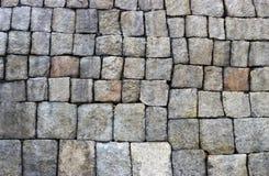 Forntida vägg av stenar närbild, textur, bakgrund royaltyfri bild