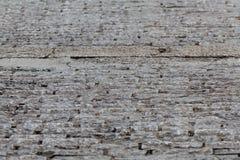 Forntida vägg och solljus Cement och tunna tegelstenar Royaltyfria Bilder
