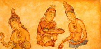 Forntida väggmålningar av molniga jungfruar på Sigiriya royaltyfri fotografi